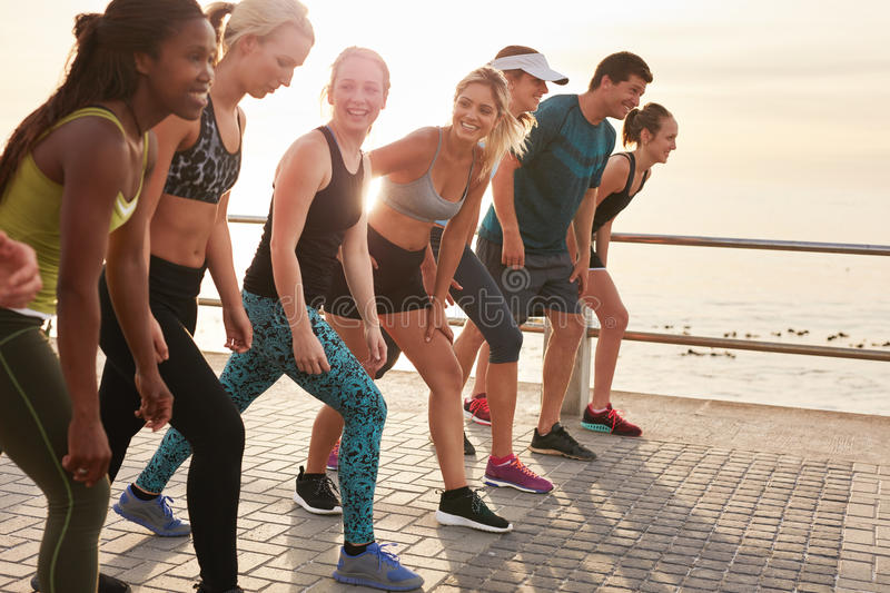 Healthy young people running together in city royalty free stock photo