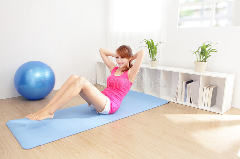 Healthy Young Woman Doing Yoga At Home Stock Photography