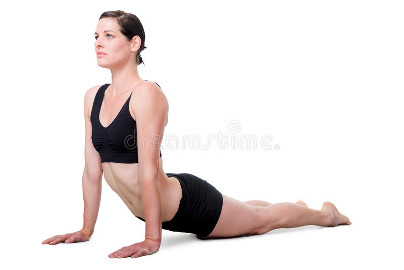 Healthy young woman exercising, isolated on white royalty free stock photos