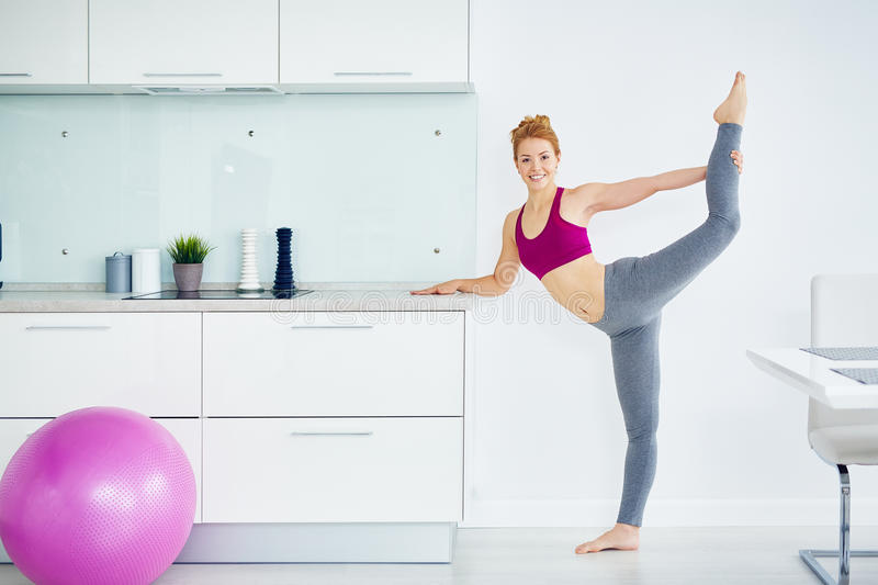 Healthy Young Woman Practicing Fitness at Home royalty free stock photos