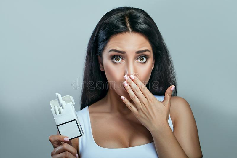 Healthy Young Woman Refusing To Take Cigarette From Pack. Portrait Of Beautiful Female Showing Stop Sign With Hand To Cigarettes. royalty free stock photos