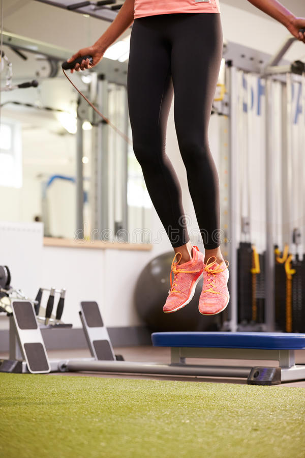 Healthy young woman skipping rope in a gym, crop. Healthy young women skipping rope in a gym, crop royalty free stock image