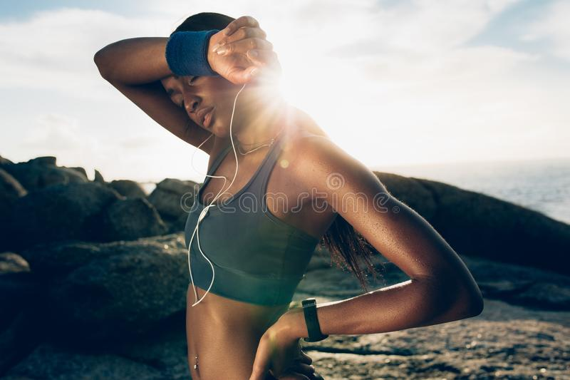 Exhausted female resting after workout royalty free stock photo