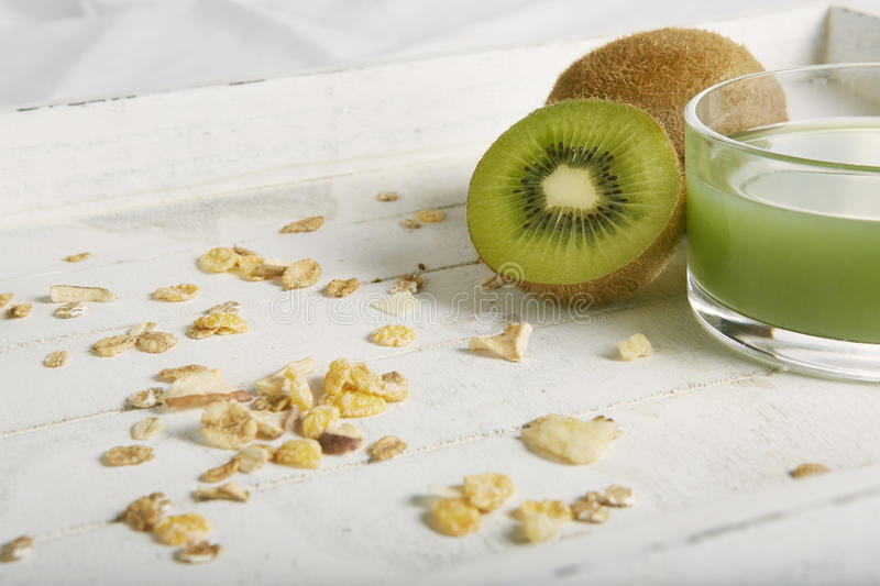 Healty breakfast with kiwi, cereals and juice royalty free stock photos