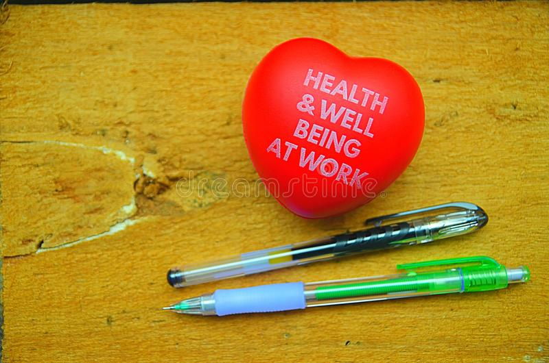 Healty och välbefinnande på arbete arkivfoto