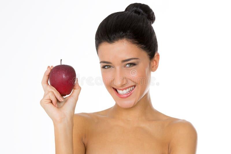Healtyvrouw met rode appel stock afbeelding