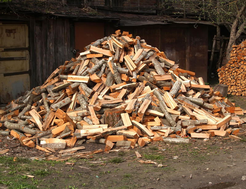 The heap of alder firewood lies in the yard.  stock photo