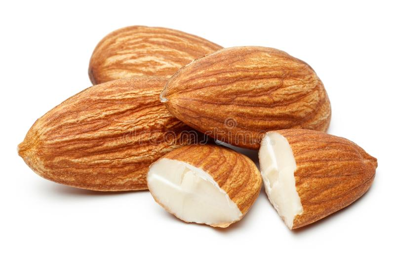 Heap of almonds isolated on white stock images