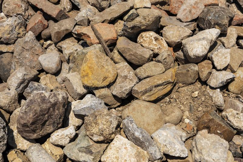 Heap of ancient building stones, pile of ancient building stones. Heap of ancient dismantled building stones, pile of ancient building stones stock image