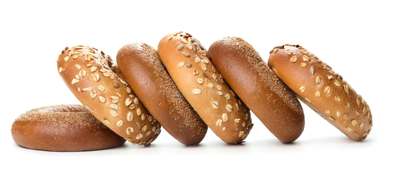 Heap of bagels. Heap of fresh baked bagels on wooden background stock images
