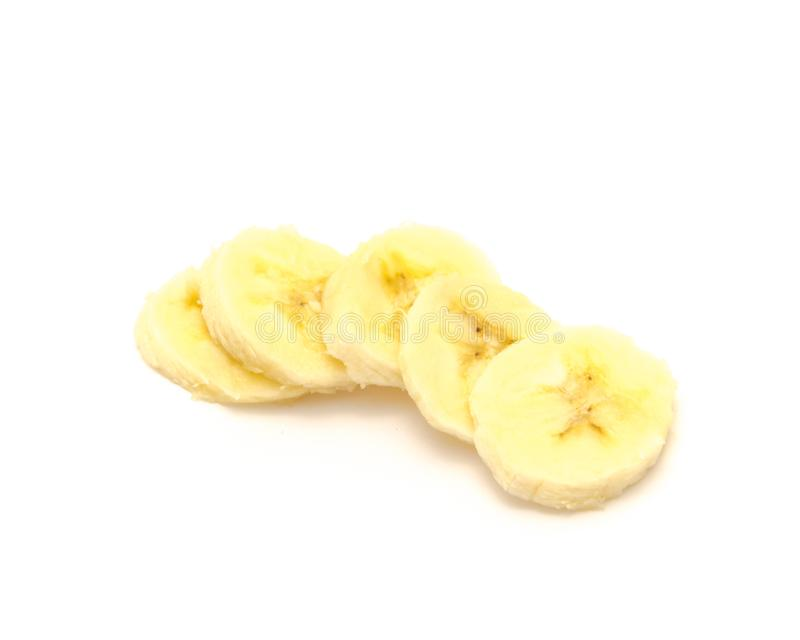 Heap of banana slices isolated on white. Food background with clipping path and copy space stock image