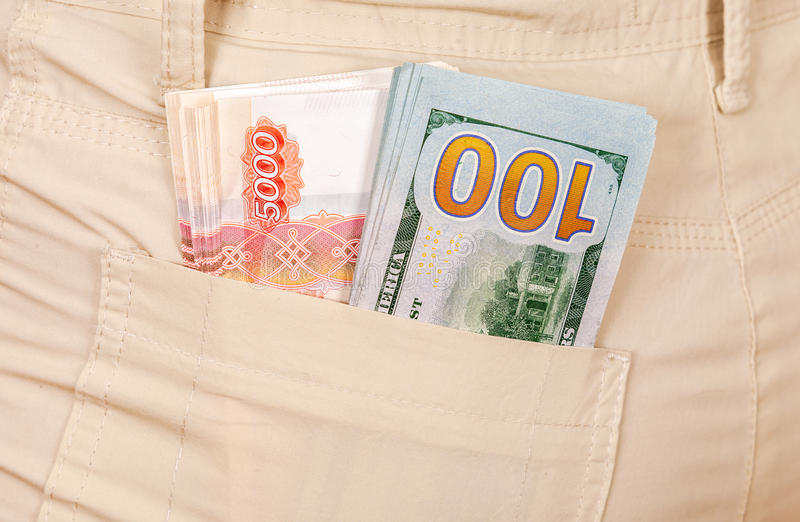 Heap banknotes of american dollars and russian rubles stock image