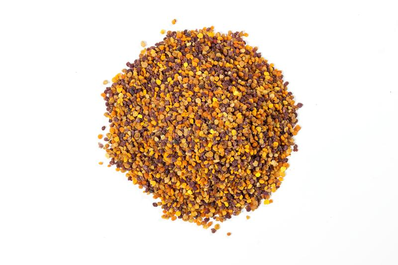 Heap of bee pollen on white background. bee product royalty free stock image