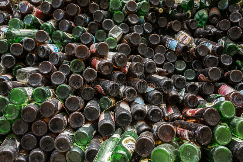 Heap of beer bottles stored outdoor for sale for recycling. royalty free stock images