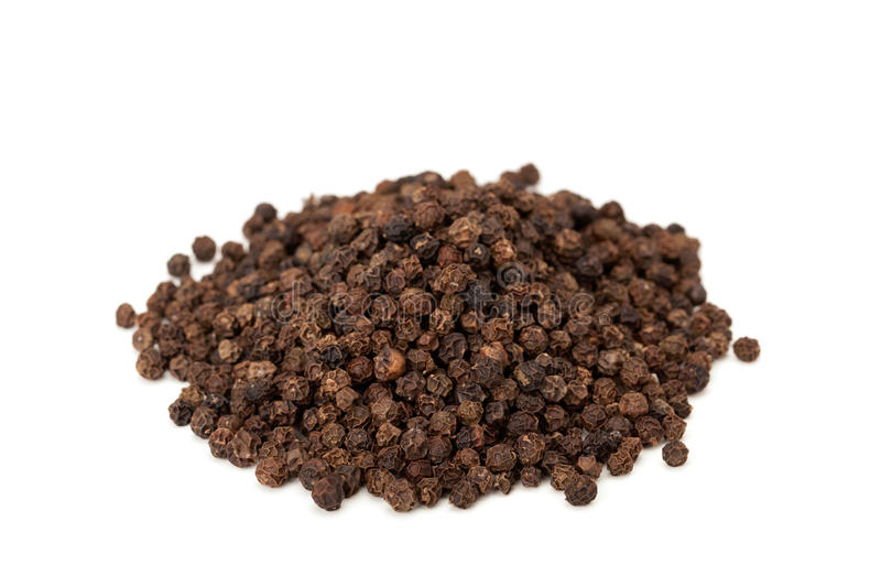 Heap of black peppercorns. Isolated on white background royalty free stock photos