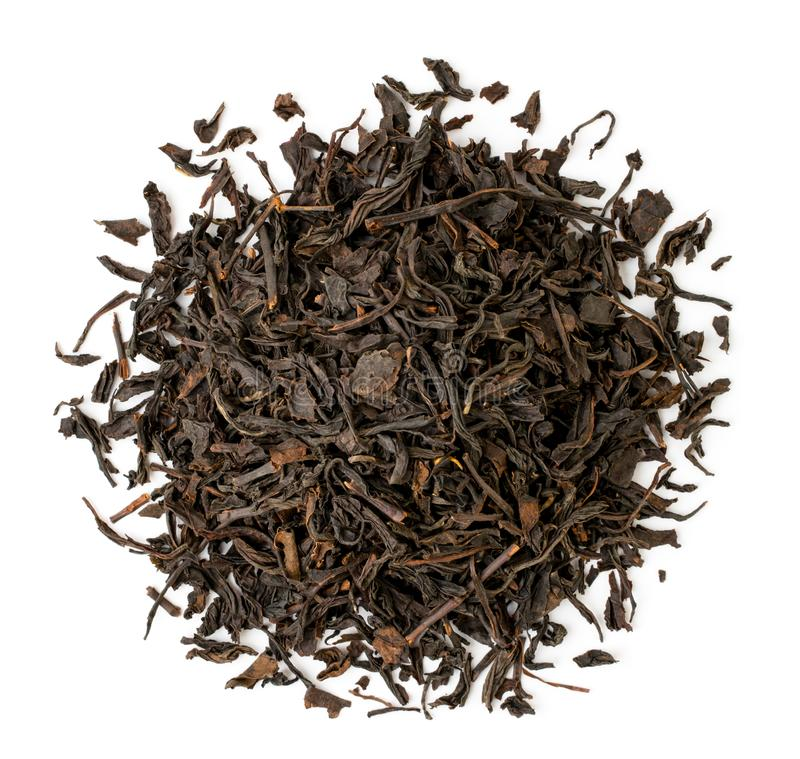 Heap of black tea leaves on a white. The form of the top. royalty free stock photos