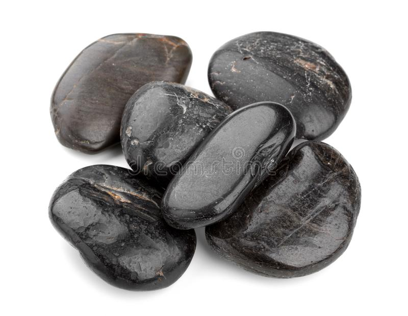 Heap of black zen pebbles isolated on white background. stock photography