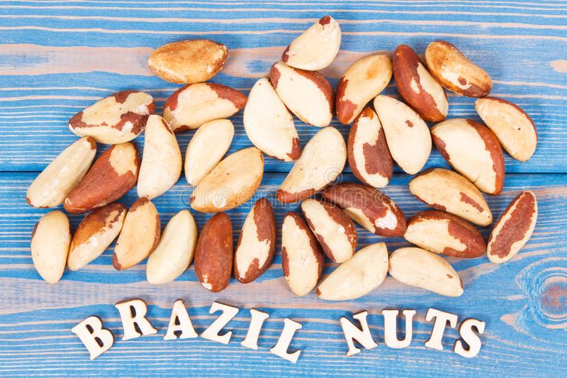 Heap of brazil nuts containing natural minerals and vitamin, health nutrition royalty free stock image