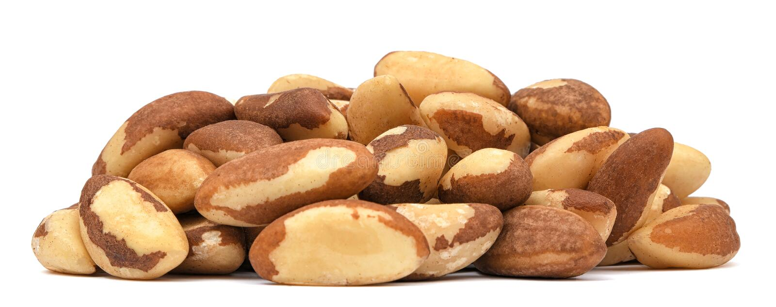Heap of Brazil nuts isolated on white background. Organic nuts stock images