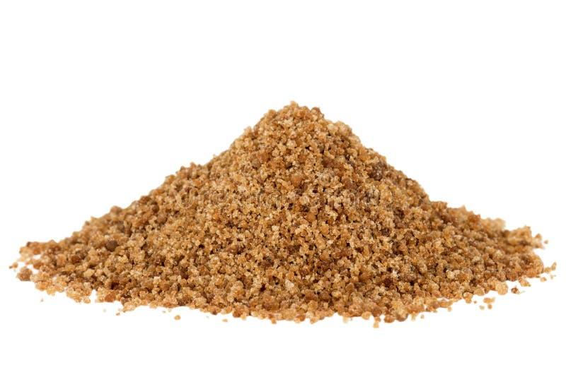 Heap of brown coconut palm sugar. Heap of organic brown coconut palm sugar, isolated on white background stock photos
