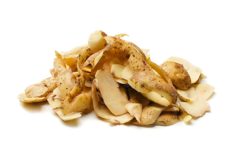Heap of brown potato peels. Isolated white background royalty free stock photo