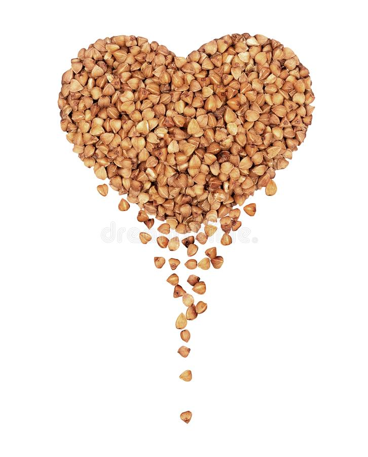 Heap of buckwheat kernels in the form of a heart.  stock photos