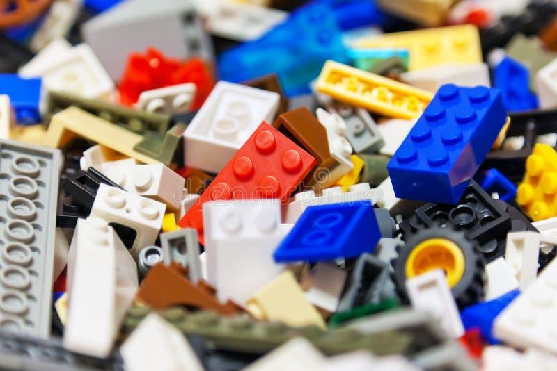 Heap of color plastic toy bricks stock photos