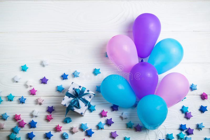 Heap of colorful balloons on white wooden background. Birthday or party background. Flat lay style royalty free stock image