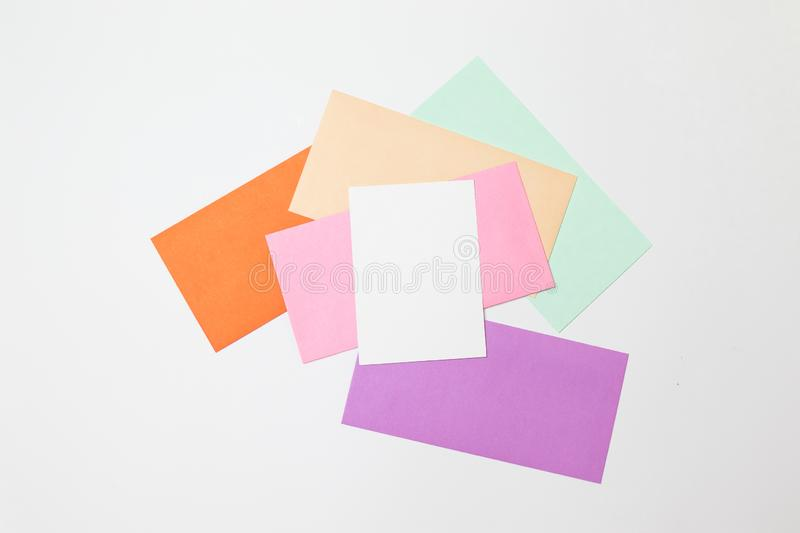 Heap of colorful envelopes on working desk. Mockup for business mail, blogging and office correspondence. Flat lay royalty free stock photo