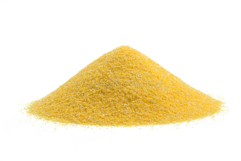 Heap of cornmeal. Isolated on white background stock photos