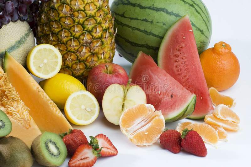 A heap of cut tropical fruits stock photos