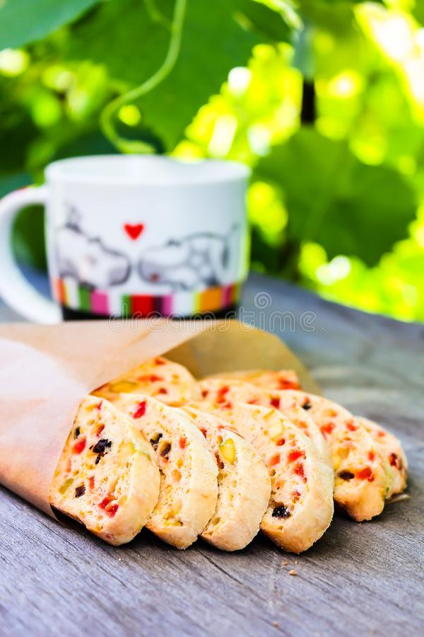 Heap of delicious Italian cantuccini cookies with dried cranberry, raisin, pistachios on a wooden table, selective focus. Summer p royalty free stock photo