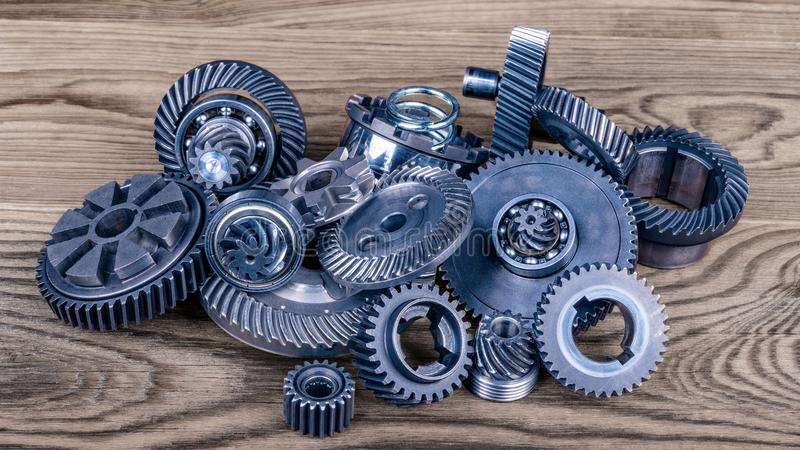 Heap of different gears on wood stock photos