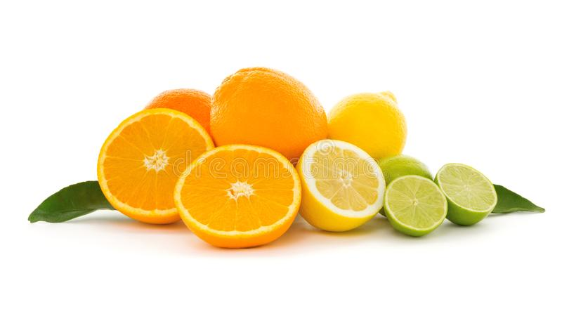 A heap of different tropical citrus fruits isolated on white background. Healthy food and nutrition, vegan lifestyle and organic f stock photo