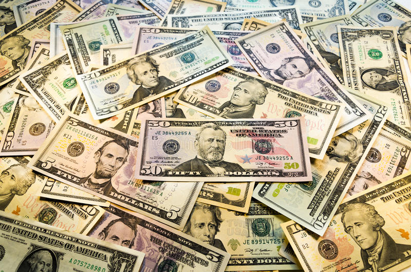 Heap of dollars. Colorful heap of dollars background royalty free stock photos
