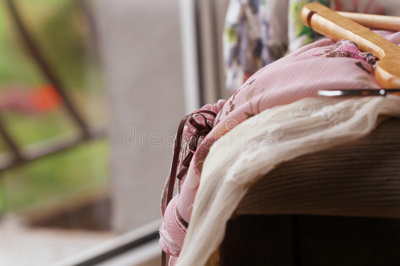 Heap of dresses on chair. (close up stock image