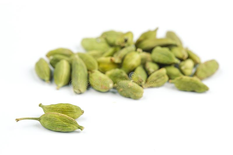 Cardamom. Heap of dried cardamom seeds isolated on white royalty free stock images