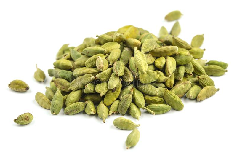 Cardamom. Heap of dried cardamom seeds isolated on white royalty free stock photo