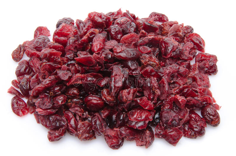 Heap of dried cranberries. Isolated on white royalty free stock photography
