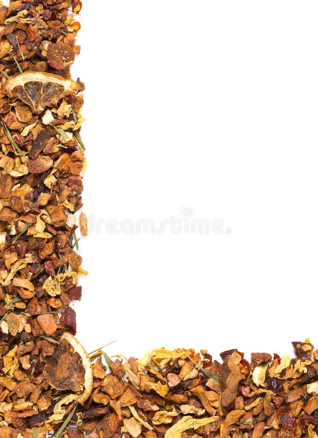 Heap of dried fruit tea infusion with oranges and strawberries mixed with tea leaves and assorted herbs frame border texture flat royalty free stock photo