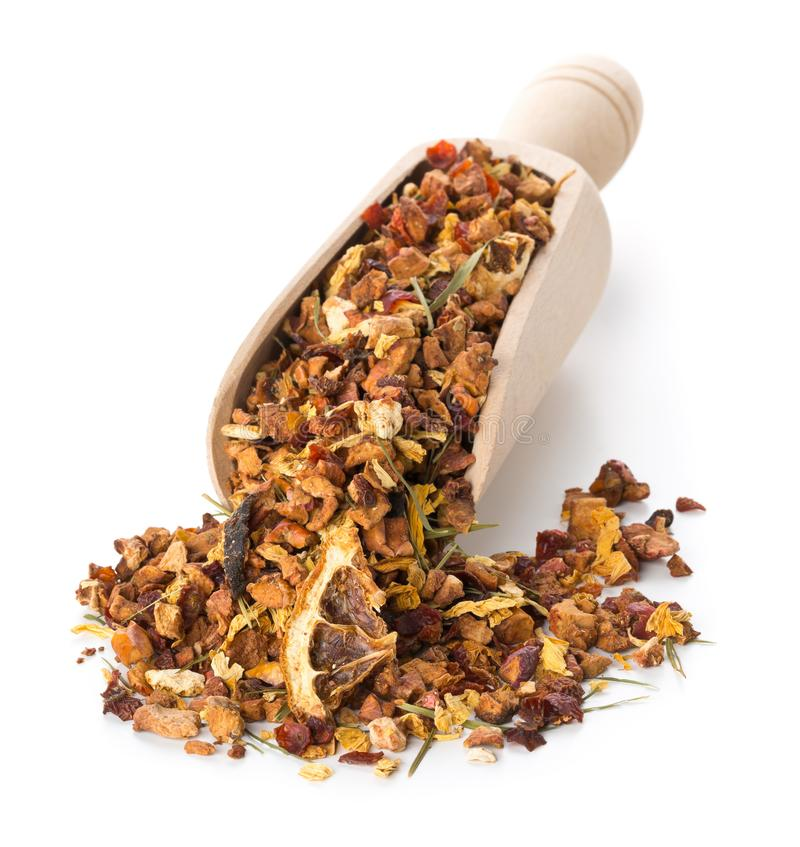 Heap of dried fruit tea infusion with oranges and strawberries mixed with tea leaves and herbs in wooden scoop over white stock images