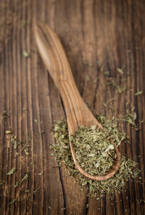 Heap of dried Stevia leaves. (sweetener) on vintage background (close-up shot stock photography