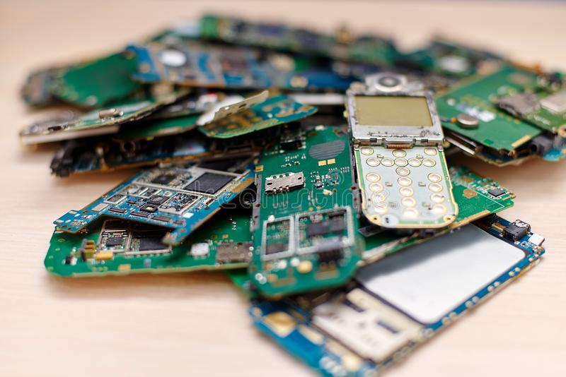 A heap of electronic boards of broken mobile phones royalty free stock image