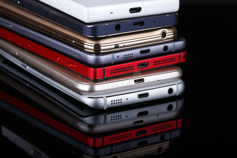Heap of electronical devices close up - smartphones stock photography