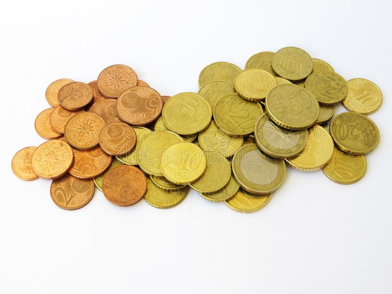 Heap of sorted euro and cents money copper coins with a white background royalty free stock photo