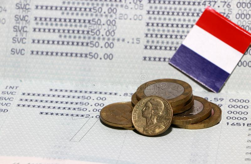 Heap of French franc coin money and mini France flag on the book bank. Concept of Saving money stock photography