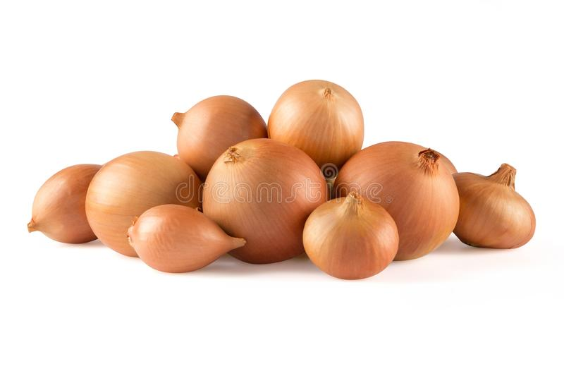 Heap of fresh beige onion bulb isolated on white background. stock photos