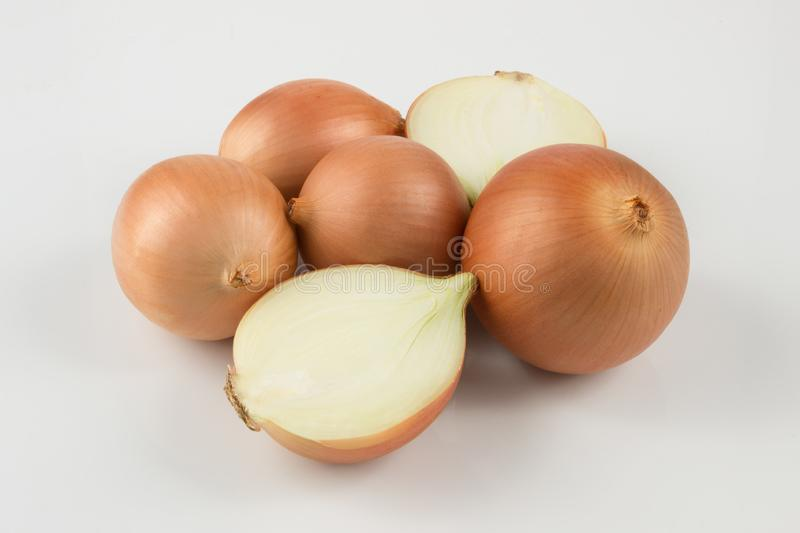 Heap of fresh beige onion bulb on white background. stock images