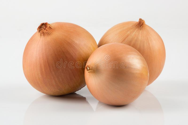 Heap of fresh beige onion bulb on white background. royalty free stock photo