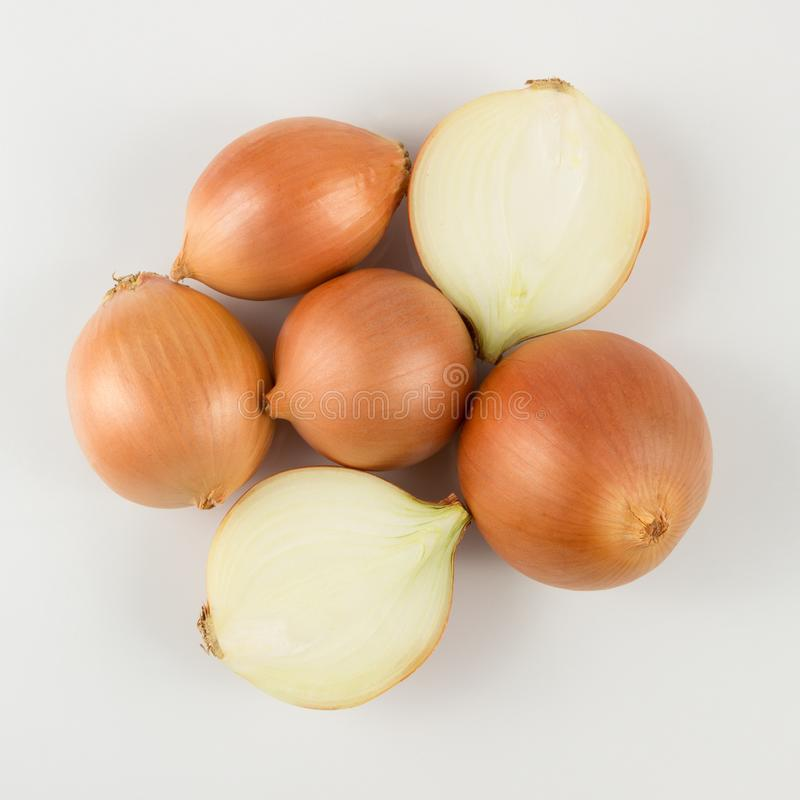 Heap of fresh beige onion bulb on white background. stock image